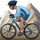 Man Mountain Biking Emoji with a Medium Skin Tone, Apple style