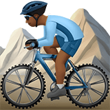 Man Mountain Biking Emoji with a Medium-Dark Skin Tone, Apple style