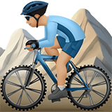 Man Mountain Biking Emoji with a Medium-Light Skin Tone, Apple style